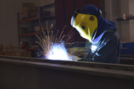 Welder at work in factory - LYF00797