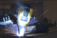 Welder at work in factory - LYF00803