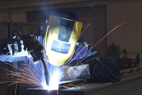 Welder at work in factory - LYF00803