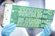 Technician examining motherboard - ZEF15265