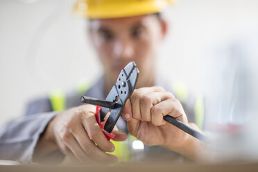 Close-up of electrician cutting wire - ZEF15364