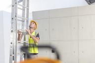 Construction worker holding ladder - ZEF15367