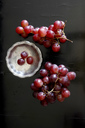 Red grapes and metal plate on dark ground - JTF00968