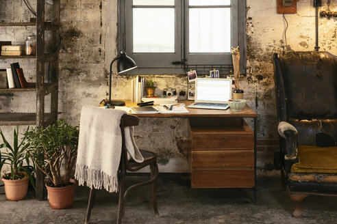 Old desk with laptop in a loft - EBSF02270