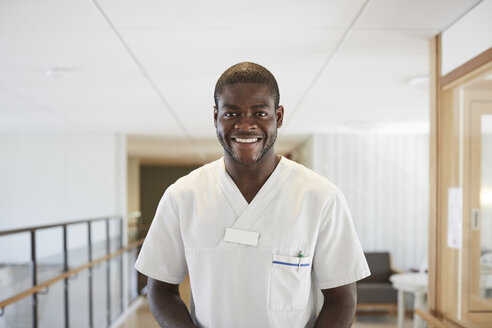 Portrait of happy male nurse standing in hospital - MASF01378