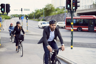 People cycling on street in city - MASF01495