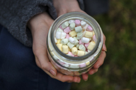 Hands holding glass of marshmallows, close-up - LBF01921