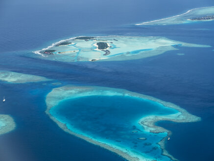 Maledives. Ross Atoll, Aerial view of island group and coral reefs - AMF05682