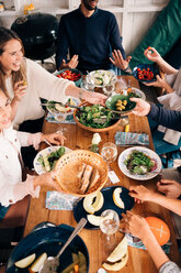 High angle view of happy friends enjoying food in cottage - MASF01742