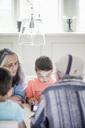 Grandparents looking at boy using digital tablet at home - MASF01796