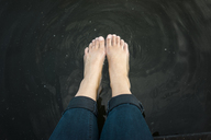Woman's feet in water of a lake - JOSF02181