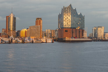 Germany, Hamburg, Harbour and Elbe Philharmonic Hall in the evening light - KEBF00806