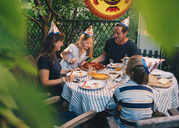 Family having garden dinner - MASF01856