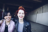 Portrait of smiling hipster female friends at parking lot - MASF02158