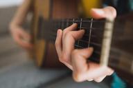 Close-up of woman playing guitar - KKAF00928