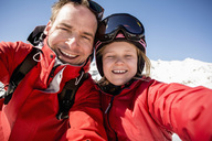 Portrait of cheerful father and daughter in warm clothing - MASF02208