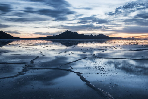 View of the Bonneville Salt Flats against cloudy sky during sunset - CAVF35574