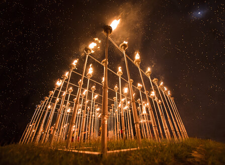Low angle view of flaming torches during loy Krathong festival at Chiang Mai - CAVF35601