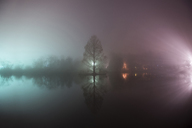 Scenic view of lake against sky during foggy weather - CAVF35610