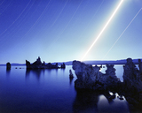 Rock formations in lake against star trails at night - CAVF35652