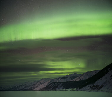 Scenic view of snowcapped mountains against aurora borealis at Northern Rocky Mountains Provincial Park - CAVF35715