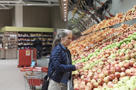 Mature woman buying apples at supermarket - MASF02306