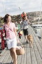 Tilt shot of family walking on jetty against sky - MASF02608