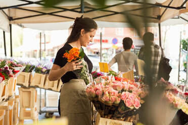 Side view of female owner working at flower shop - MASF02869