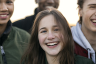Portrait of teenage girl standing with friends - MASF02914