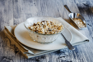 Glass bowl of homemade granola - EVGF03348