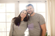 Portrait of happy father and daughter standing at new home - MASF02978