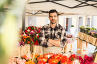 Portrait of confident male owner standing arms crossed in flower shop - MASF02984