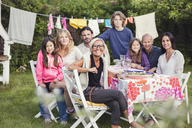Portrait of happy family and friends in back yard during garden party - MASF03005
