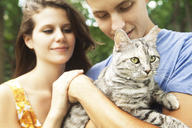 Couple with cat in park - CAVF36253