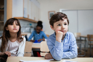 Concentrated children sitting at desk in classroom - MASF03142