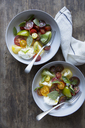 Directly above shot of salad in bowls with forks on wooden table - MASF03157
