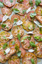 Full frame shot of sliced tomatoes with garlic and basil - MASF03182