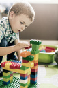 Boy playing with toy blocks at home - MASF03209