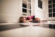 Boy sleeping on floor - CAVF37903