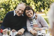 Portrait of loving senior couple having desserts at cafe table - MASF03404