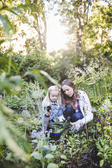 Mother and daughter planting on field - MASF03494