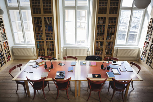High angle view of empty chairs with table in board room at law library - MASF03593