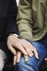 Cropped image of senior man touching caretaker's hand - MASF03686