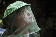 Close-up of a little girl wearing beekeepers veil - MASF03719
