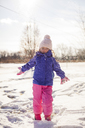 Portrait of girl standing on snowy field against sky - CAVF38289