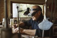 Senior craftsman working in workshop - MASF03984