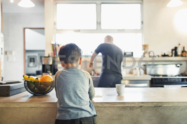 Rear view of father and son in kitchen - MASF04056