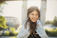 Portrait of happy teenager hanging at park - MASF04071