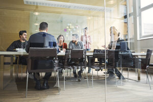 Multi-ethnic business people having discussion in conference room - MASF04128