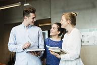 Happy friends talking in classroom - MASF04229